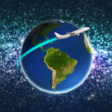 Airplane circling a colorful earth Stock Images