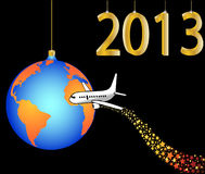 Airplane circling the globe merry christmas  happy. New year 2013  illustration Royalty Free Stock Images