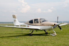 Airplane Cirrus SR22 stand in ground. Stock Photography