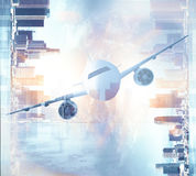 Airplane on city background. Front view of airplane on abstract city background. Double exposure Royalty Free Stock Images