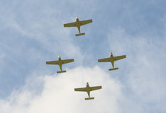 Airplanes in close group. The four airplanes fly at a short distance from each other in a rhombus Stock Photos