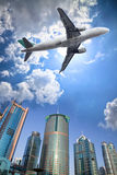 Airplane and cloud Stock Image