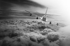 Airplane Cloud travel sky aviation air speed plane background blue Royalty Free Stock Photo
