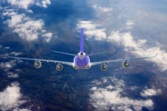 Airplane Cloud travel sky aviation air speed plane background blue Stock Images