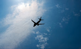Airplane and clouds Royalty Free Stock Photography