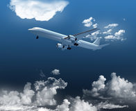 Airplane in the clouds Royalty Free Stock Photo