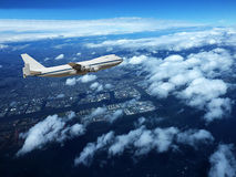 Airplane in clouds background. Royalty Free Stock Photo