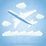 Airplane and clouds Stock Photos