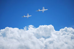 Airplane in the clouds Royalty Free Stock Images