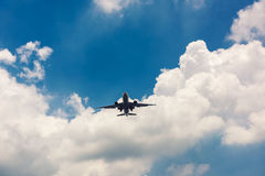 Airplane on the clouds sky preparation for landing Royalty Free Stock Image