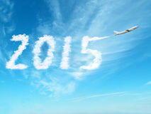 2015 with airplane on clouds sky Stock Photos