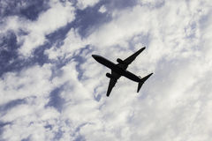 Airplane on a cloudy background royalty free stock photography