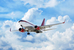 Airplane in cloudy sky. Flying up passenger airplane in cloudy sky Stock Image