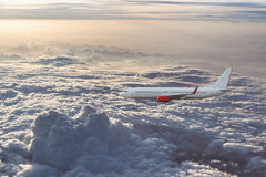 Airplane in the cloudy sky Royalty Free Stock Images