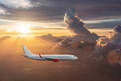 Airplane in the cloudy sky Stock Photo