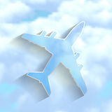 Airplane on a cloudy sky background Stock Photography