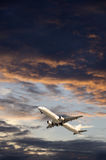 Airplane in a cloudy sky Royalty Free Stock Image