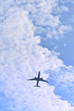 Airplane with cloudy sky Royalty Free Stock Image