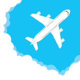 Airplane in a cloudy sky Royalty Free Stock Photography