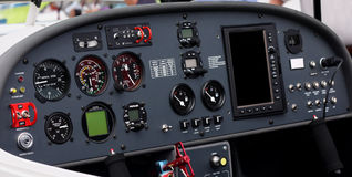 Airplane cockpit. Instrument panel of a small airplane. Focus is on the left half of the image. The altitude and airspeed dials are easily readable at full size Stock Photography