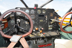 Airplane cockpit. Cockpit and instrumentation in vintage propeller airplane Stock Photography