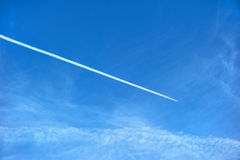 Airplane contrail. Against blue sky stock photos