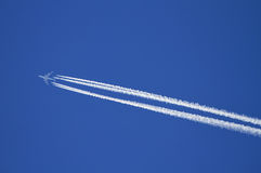 Airplane with contrails. Stock Photography