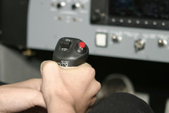Airplane Controls. A hand gripping the controls for an aircraft. This photograph was taken in a flight simulator stock images