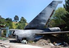 Airplane crash. Burning plane after the crash royalty free stock photos