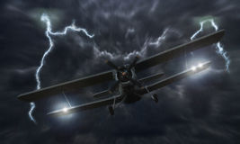 Airplane crash. Biplane crash in a storm with lightning concept. Accident airplane in the sky. Emergency landing. Flights in bad weather Royalty Free Stock Photography