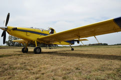 Airplane crop duster. A parked crop duster in Illinois field Royalty Free Stock Image