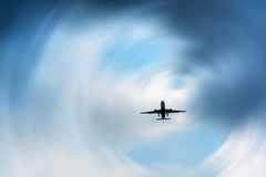 Airplane in the dark skies before storm, Abstract transportation. Stock Images