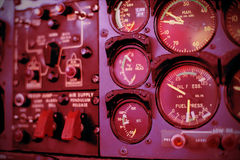 Airplane dashboard. Control clocks in red tone Royalty Free Stock Photos