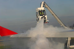 Airplane de-icing Stock Photo