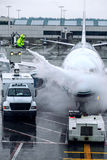 Airplane deicing from bucket vertical Royalty Free Stock Images