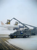 Airplane Deicing Operations. Of an aircraft during a winter storm Royalty Free Stock Photography