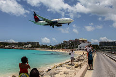 Airplane Delta is landing on Princess Juliana International Airp Royalty Free Stock Photography