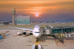 Airplane is at Ariport in Hong Kong. stock photos