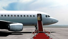 Airplane departure entrance with red carpet Stock Photos