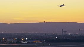 Airplane departure at sunset stock video footage