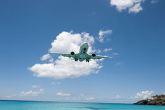 Airplane Descending. Airplane over ocean, preparing to descend Stock Image
