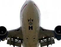Airplane detail from below. Close-up of the underneath of an airplane with its flaps and gear down Stock Photo
