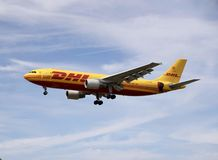 A airplane of DHL express flying in the sky royalty free stock photo