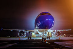 Airplane docked at the terminal. And ready for takeoff. Modern international airport at night royalty free stock photo