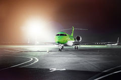 Airplane docked at the terminal. And ready for takeoff. Modern international airport at night stock photos