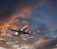 Airplane dramatic cloudscape takeoff. Airplane takeoff or landing against dramatic cloudscape background Stock Images