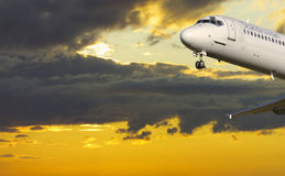 Airplane in dramatic sky. Airplane flying under dramatic sky and clouds Royalty Free Stock Photos