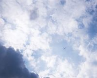 Airplane in dramatic sky Royalty Free Stock Photography