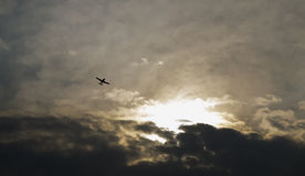 Airplane with dramatic sky. Flying airplane with dramatic sky Royalty Free Stock Photo