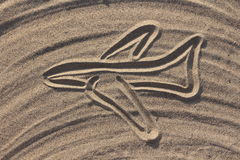 Airplane draw on the sand in the beach Royalty Free Stock Photos